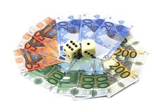 Würfelt auf Geld Stockfotografie