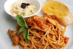 Würzige rote Currysoße der Spaghettis Lizenzfreie Stockbilder