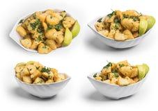 Würziger Kartoffelschnitt in den Würfeln und gebratene, libanesische Küche, Satz der würzigen Kartoffel, Beschneidungspfad einges Lizenzfreies Stockbild