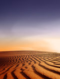 Wüstenlandschaft am Sonnenuntergang Stockfotografie