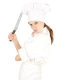 Wütende Kochfrau mit Messer Stockfoto
