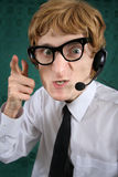Wütender nerdy Telefonbediener Stockfotografie