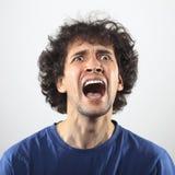 Wütendes Porträt des jungen Mannes Stockbild
