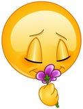 Wąchać kwiatu emoticon Zdjęcie Stock