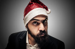 Wątpliwy nowożytny elegancki Santa Claus babbo natale Fotografia Stock