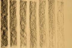 Węgla drzewnego deseniowy rysunek na koloru żółtego papieru tła teksturze Fotografia Stock