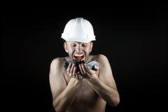 Węglowy górnik na czarnym tle Obrazy Royalty Free