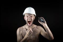 Węglowy górnik na czarnym tle Zdjęcia Royalty Free