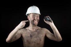 Węglowy górnik na czarnym tle Fotografia Stock