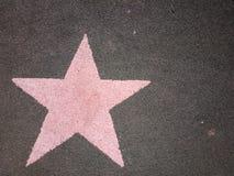 Właśnie różowa gwiazda na ziemi Obrazy Royalty Free