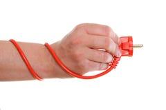 Władzy kabel na biały tle w ręce Obraz Royalty Free