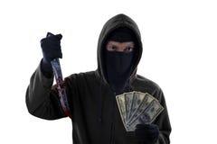 Włamywacza chwyta krwisty nóż i dolar Zdjęcie Royalty Free