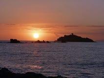 Włochy, Tuscany, Grosseto, Punta ałuny, widok Wróblia wyspa lub także nazwany Troja przy zmierzchem, obraz stock
