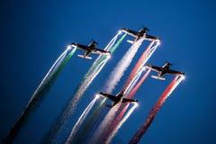 Włoska aerobatics drużyna przy półmrokiem fotografia royalty free