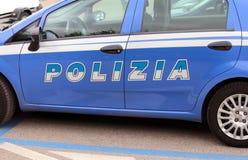 Włoski błękitny samochód policyjny w ulicie Obrazy Stock