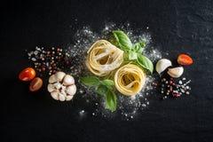 Włoski jedzenia i składników tło z, pomidory, czosnek, s Zdjęcia Stock