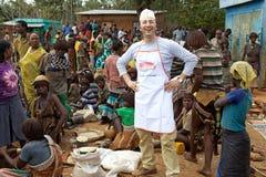 Afrykanina targowy i włoski sprzedawca Zdjęcia Stock