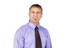 W średnim wieku biznesowego mężczyzna ono uśmiecha się Obrazy Stock