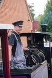 W średnim wieku mężczyzna jedzie Wąskiego wymiernika pociąg Obraz Royalty Free