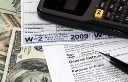 W-2 Form. W-2 and W-9 Forms on US dollars Stock Photography