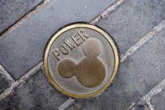 Władzy dziury pokrywa z Mickey Mouse imprinted Fotografia Stock