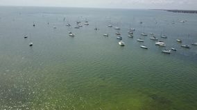Beautiful 4k aerial drone flight over small yacht motor boat sailing in calm blue harbor bay water in tropical seascape. W aerial 4k drone flight over small stock footage