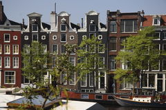 W Amsterdam kanałowi domy Fotografia Stock