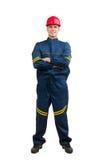 W błękit mundurze młody szczęśliwy pracownik budowlany Zdjęcia Stock