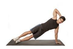 W czerń sporta mężczyzna jest ćwiczy Obraz Royalty Free