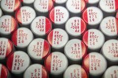 W górę makro- zakończenie wyrównywał polimerów elektrolitowych capacitors narzędzia elektroniki teletechnicznych składniki pakują obraz stock