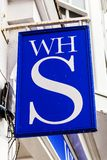 W H Smiths stationary newsagent sign. Tenby, Wales, UK, November 4, 2018 : W H Smiths stationary newsagent retail store in the High Street stock photo