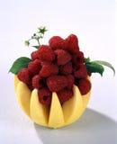W jabłku świeże malinki Obrazy Royalty Free