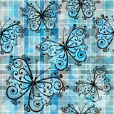 W kratkę bezszwowy wzór z motylami Fotografia Stock