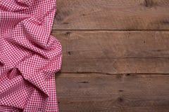 W kratkę tkanina jak granicę na drewnianym tle dla bożych narodzeń lub Obraz Stock