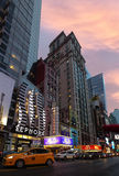 W 42nd St in NYC in the evening. NEW YORK, USA - Apr 30, 2016: W 42nd St in NYC in the evening. 42nd Street is a major crosstown street in the NYC, known for its Royalty Free Stock Photography