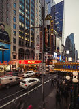 W 42nd St in NYC in the evening. NEW YORK, USA - Apr 30, 2016: W 42nd St in NYC in the evening. 42nd Street is a major crosstown street in the NYC, known for its Stock Photography