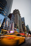 W 42nd St in NYC in the evening. NEW YORK, USA - Apr 30, 2016: W 42nd St in NYC in the evening. 42nd Street is a major crosstown street in the NYC, known for its Stock Images