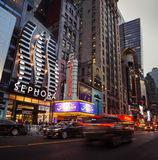 W 42nd St in NYC in the evening. NEW YORK, USA - Apr 30, 2016: W 42nd St in NYC in the evening. 42nd Street is a major crosstown street in the NYC, known for its Stock Photo