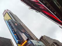 W New York Hotel. NEW YORK CITY, USA - JANUARY 3 : A low angle view of the publicity screens and the W New York Times Square Hotel on Broadway in Manhattan on stock images