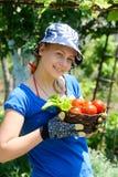 W ogródzie kobiety działanie Fotografia Stock