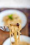 Włoski makaron i pieczarkowy kumberland Zdjęcia Royalty Free