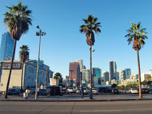627 W Pico Boulevard. California, Los Angeles. Street. View. Three palm trees and some people. Blue sky Stock Image
