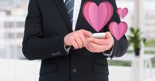 W połowie sekcja biznesmen używa telefon komórkowego Fotografia Royalty Free