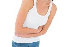 W połowie sekcja przypadkowa kobieta z żołądka bólem fotografia stock