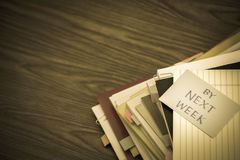W przyszłym tygodniu; Stos Biznesowi dokumenty na biurku Fotografia Stock
