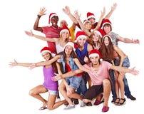 W Santa kapeluszu grupowi ludzie. Obrazy Royalty Free