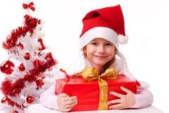 W Santa kapeluszu szczęśliwa mała dziewczynka Fotografia Royalty Free
