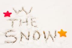 W scritto la neve Fotografia Stock