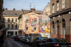 Wąska ulica Lviv z graffiti Obraz Royalty Free