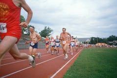 W Starszych Olimpiadach starsi męscy biegacze Zdjęcia Royalty Free